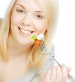 吃健康食物的女孩 免版税图库摄影