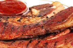 吃准备好的供食的牛排 免版税库存照片