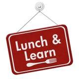 吃午餐并且学会标志 库存照片