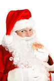 吃圣诞节曲奇饼的圣诞老人 图库摄影