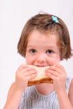 吃女孩少许三明治 库存图片