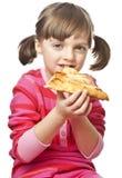 吃女孩少许薄饼 库存图片