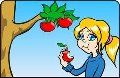 吃女孩的苹果 图库摄影
