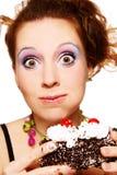 吃女孩的蛋糕 免版税库存图片