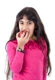 吃女孩年轻人的苹果 免版税库存照片
