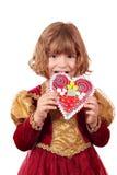吃姜饼的小女孩 库存照片