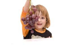 吃孩子应该的果子 库存图片