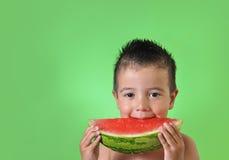 吃孩子西瓜 免版税库存图片