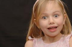 吃惊的女孩少许纵向 免版税库存图片