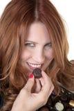 吃我喜爱的巧克力 库存照片