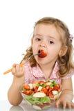 吃果子女孩少许沙拉 图库摄影