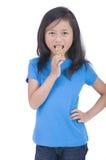 吃格兰诺拉麦片的棒 免版税库存图片