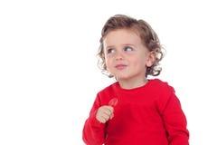 吃棒棒糖的可爱的婴孩 库存照片