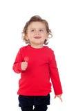 吃棒棒糖的可爱的婴孩 免版税库存图片