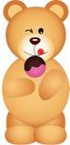 吃棒棒糖的玩具熊 图库摄影