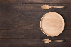 吃概念 木盘、木匙子和木头叉子在w设置了 库存照片