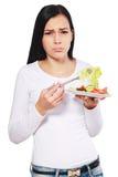 吃沙拉的妇女乏味 库存照片