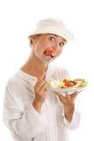 吃沙拉的妇女 免版税库存照片