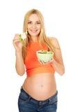 吃沙拉的孕妇 免版税图库摄影