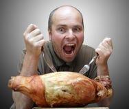 吃火腿饥饿的食客 免版税库存照片