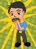 吃炸玉米饼 免版税图库摄影