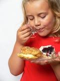 吃甜点的子项 免版税库存照片