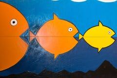 吃的三条鱼绘画  免版税图库摄影