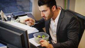 吃的办公室工作者谈话和 库存照片
