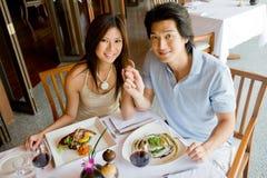 吃的夫妇晚餐 图库摄影