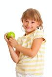 吃绿色查出的纵向女小学生的苹果 图库摄影