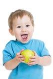 吃绿色苹果的男婴,查出在白色 免版税库存图片