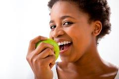 吃苹果的美丽的女孩 库存图片