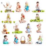 吃苹果的婴孩和孩子的汇集 免版税图库摄影