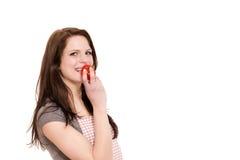 吃蕃茄妇女年轻人 库存照片
