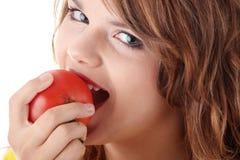 吃蕃茄妇女 库存图片