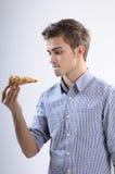 吃薄饼少年 免版税图库摄影
