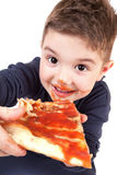 吃薄饼年轻人的男孩 免版税库存照片