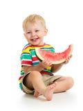 吃西瓜的儿童男孩 免版税图库摄影