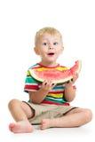 吃西瓜的孩子男孩 免版税库存图片