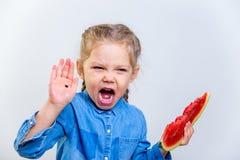 吃西瓜的孩子 库存照片