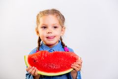 吃西瓜的孩子 库存图片