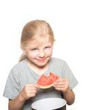 吃西瓜的孩子 免版税图库摄影