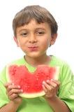 吃西瓜的男孩 免版税库存图片
