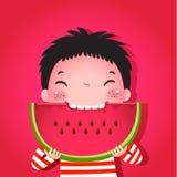 吃西瓜的逗人喜爱的男孩 免版税库存照片