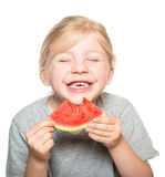吃西瓜2的孩子 免版税库存图片