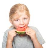 吃西瓜3的孩子 免版税图库摄影
