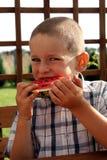 吃西瓜 免版税图库摄影