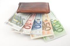 吃货币的钱包 免版税库存照片