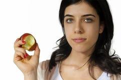 吃食物女孩健康年轻人 免版税库存图片