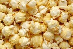 吃食物宏观玉米花的背景构造了 免版税库存图片